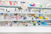 istock pharmacy drugstore shop interior blur background 897329810
