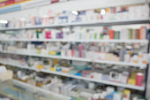 istock pharmacy drugstore shop interior blur background 897784374