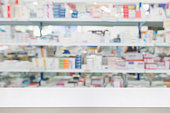 istock pharmacy drugstore shop interior blur background 908874426
