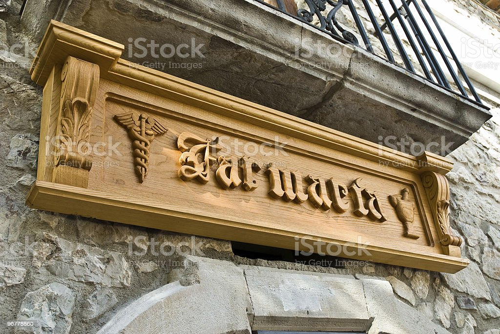 Pharmacy Sign on a Wood Plate royalty-free stock photo