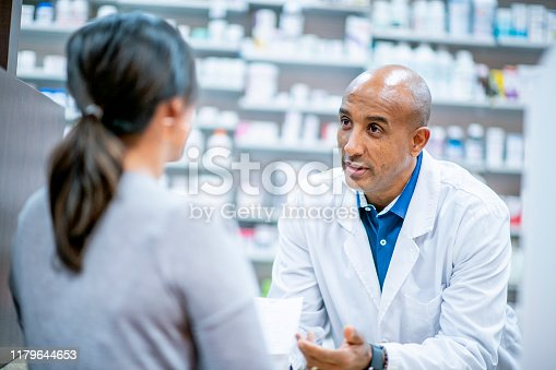 Medical professionals and pharmacists provide medication at the pharmacy.