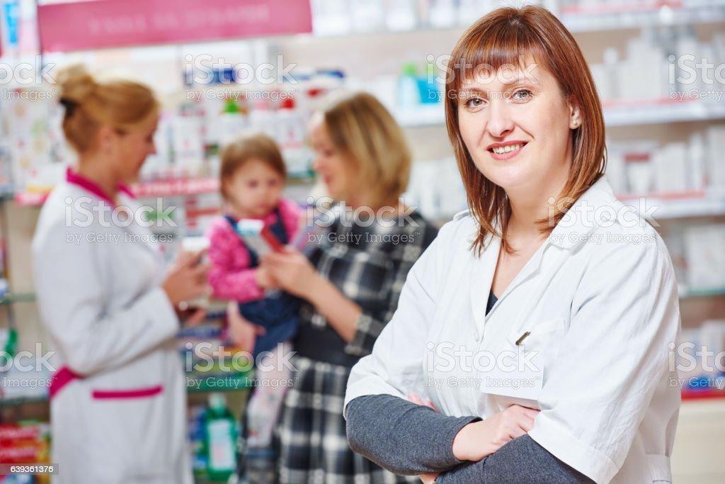 Pharmacy store. Female pharmacist portrait stock photo