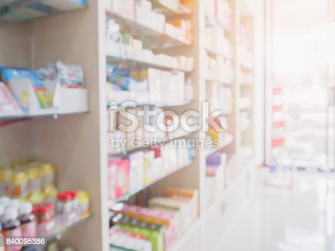 istock pharmacy store interior with medicine on medical shelves blur background 840095386