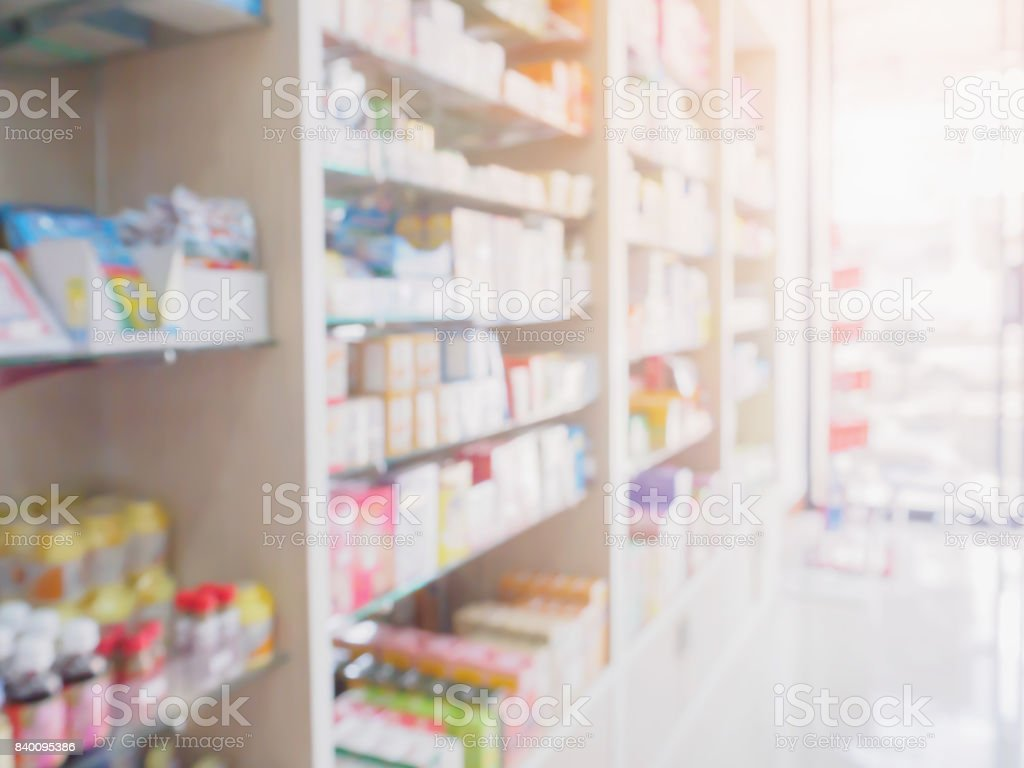 pharmacy store interior with medicine on medical shelves blur background stock photo