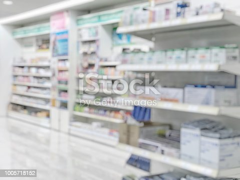 istock Pharmacy store or drugstore blur background with drug shelf and blurry pharmaceutical products, cosmetic and medication supplies on shelves inside retail shop interior 1005718152