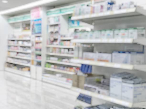 pharmacy store or drugstore blur background with drug shelf and blurry pharmaceutical products, cosmetic and medication supplies on shelves inside retail shop interior - pharmacy stock pictures, royalty-free photos & images