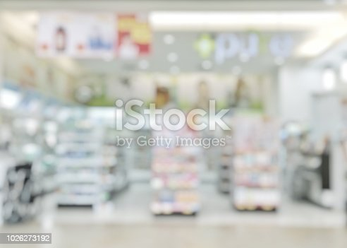 istock Pharmacy store or drugstore blur background with drug shelf and blurry pharmaceutical products, cosmetic and medication supplies on shelves inside retail shop interior 1026273192