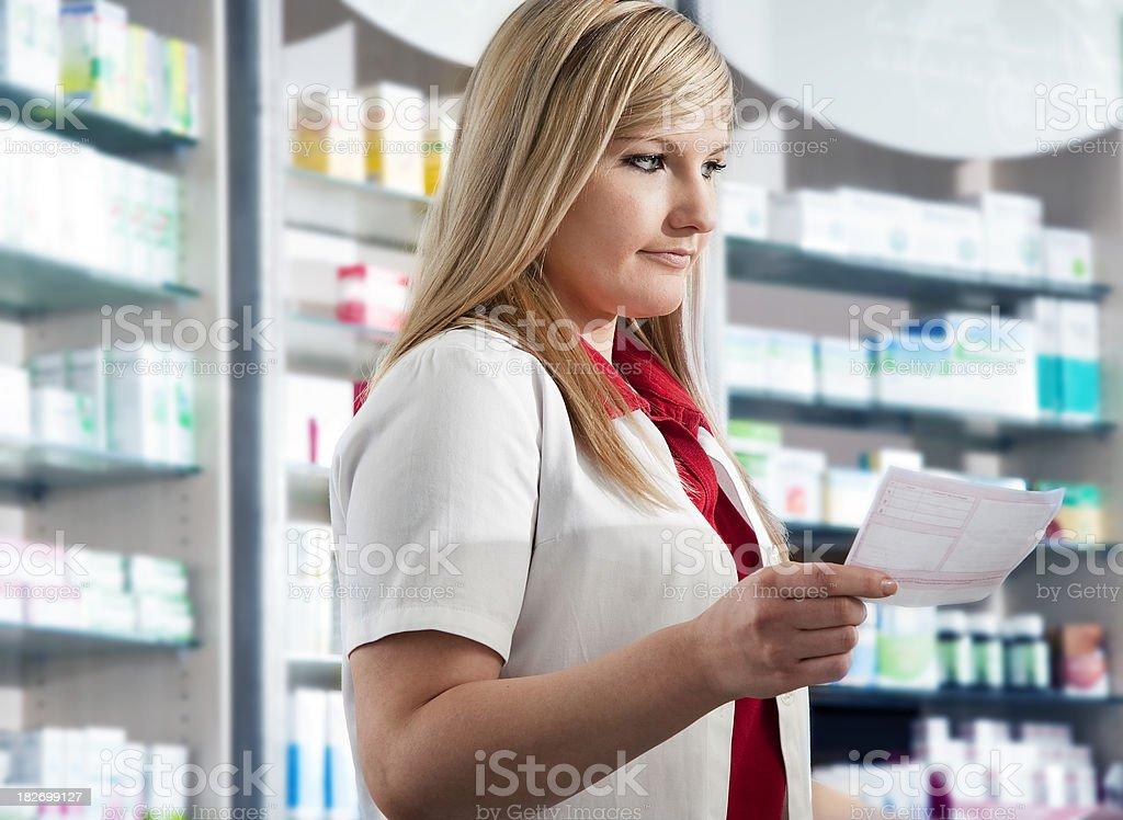 Pharmacy Technician Reading a Prescription stock photo