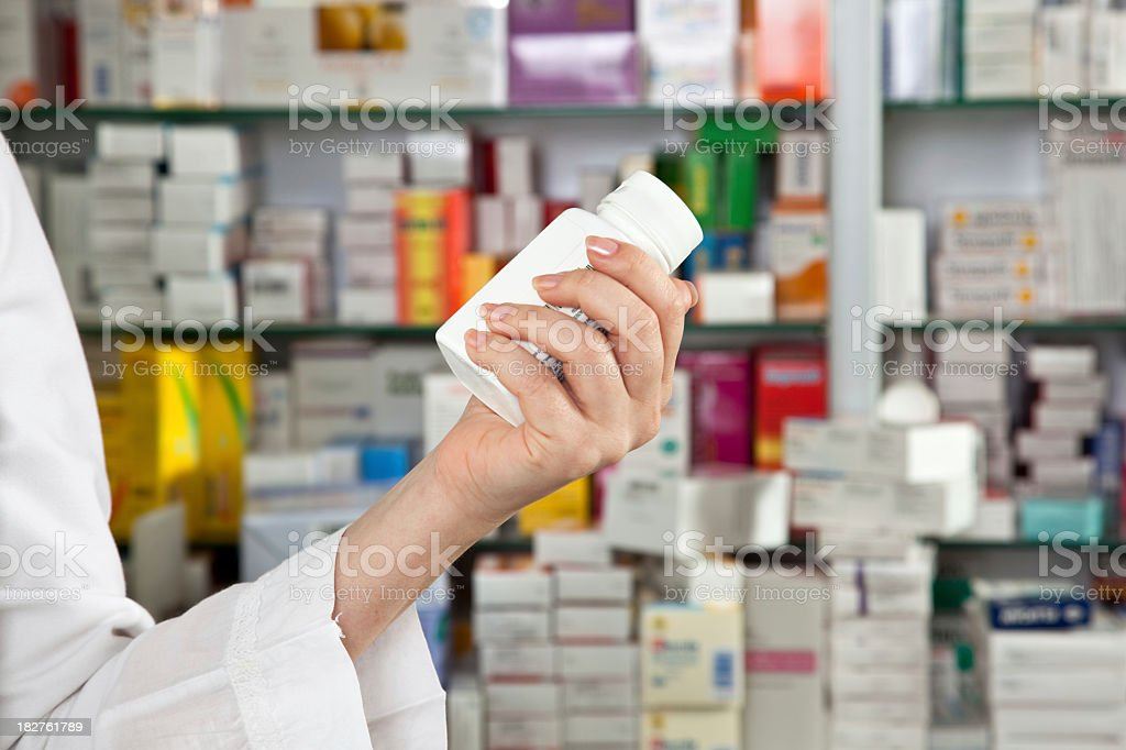 Pharmacy worker checking labels royalty-free stock photo