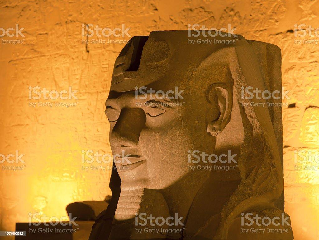 Pharoh statue lit up at night stock photo