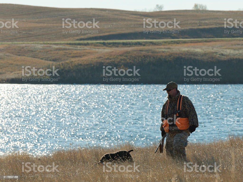 Pheasant Hunter and his dog stock photo