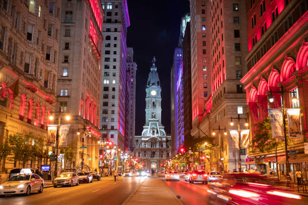 Philadelphia City Hall and clock tower on Broad Street at night stock photo