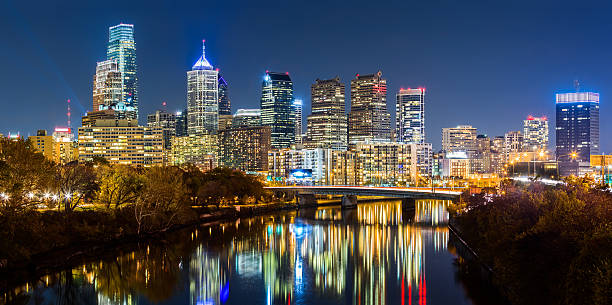 philadelphia cityscape panorama by night - philadelphia skyline stock photos and pictures
