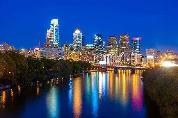 philadelphia downtown and the schuylkill river during the evening - philadelphia skyline stock photos and pictures