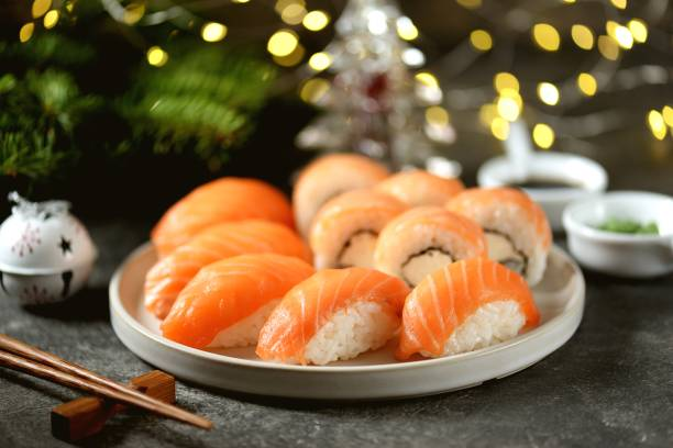 Philadelphia homemade sushi rolls and nigiri sushi with wild salmon,  christmas background. stock photo