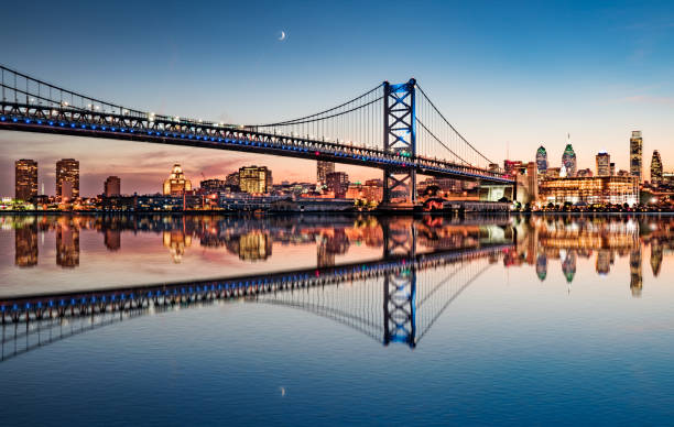 philadelphia night skyline refection - philadelphia skyline stock photos and pictures