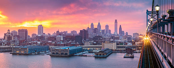 philadelphia panorama under a hazy purple sunset. - philadelphia skyline stock photos and pictures