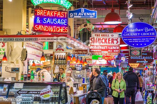 Philadelphia, Pennsylvania - November 18, 2016: Vendors and customers in Reading Terminal Market. The historic market is a popular attraction for culinary treats.