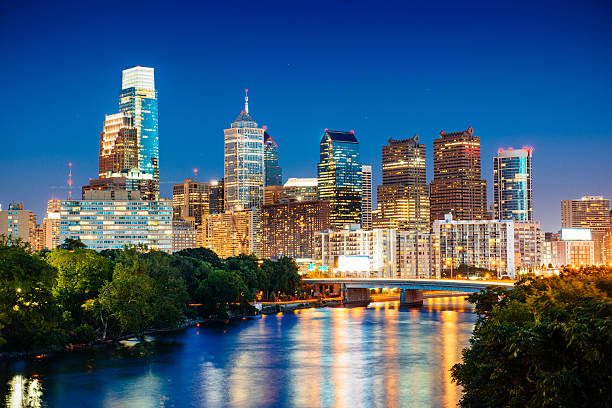 philadelphia skyline at dusk over schuylkill river - philadelphia skyline stock photos and pictures