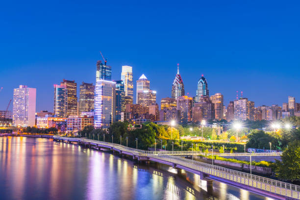philadelphia skyline at night with reflection in river. stock photo