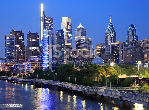 Philadelphia skyline at night with the Schuylkill River on the foreground, USA