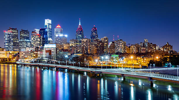 philadelphia skyline by night - philadelphia skyline stock photos and pictures