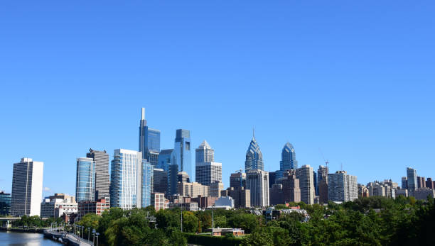philadelphia skyline on a clear sunny day - philadelphia skyline stock photos and pictures