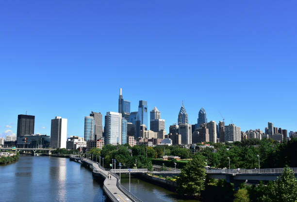 philadelphia skyline on a clear sunny day with the schuylkill river in the foreground - philadelphia skyline stock photos and pictures