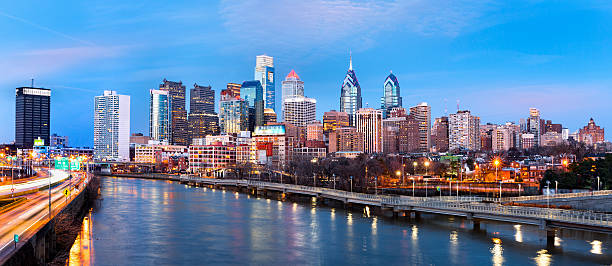 philadelphia skyline panorama at dusk - philadelphia skyline stock photos and pictures