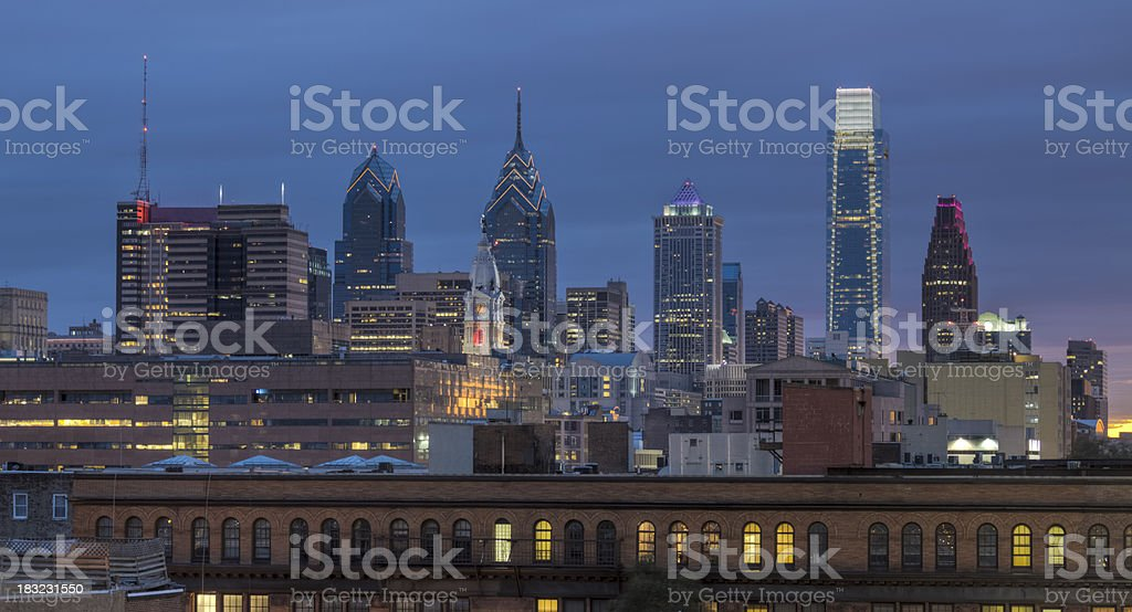 Philadelphia Skyline with Buildings Aglow Just After Sunset stock photo