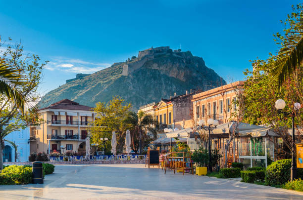 Philellinon square in Nafplio-The historic square of the city located in the old town.The castle of Palamidi in the background. stock photo