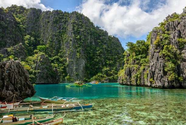 philippine boats in the lagoon of coron island, palawan, philippines - philippines stock photos and pictures