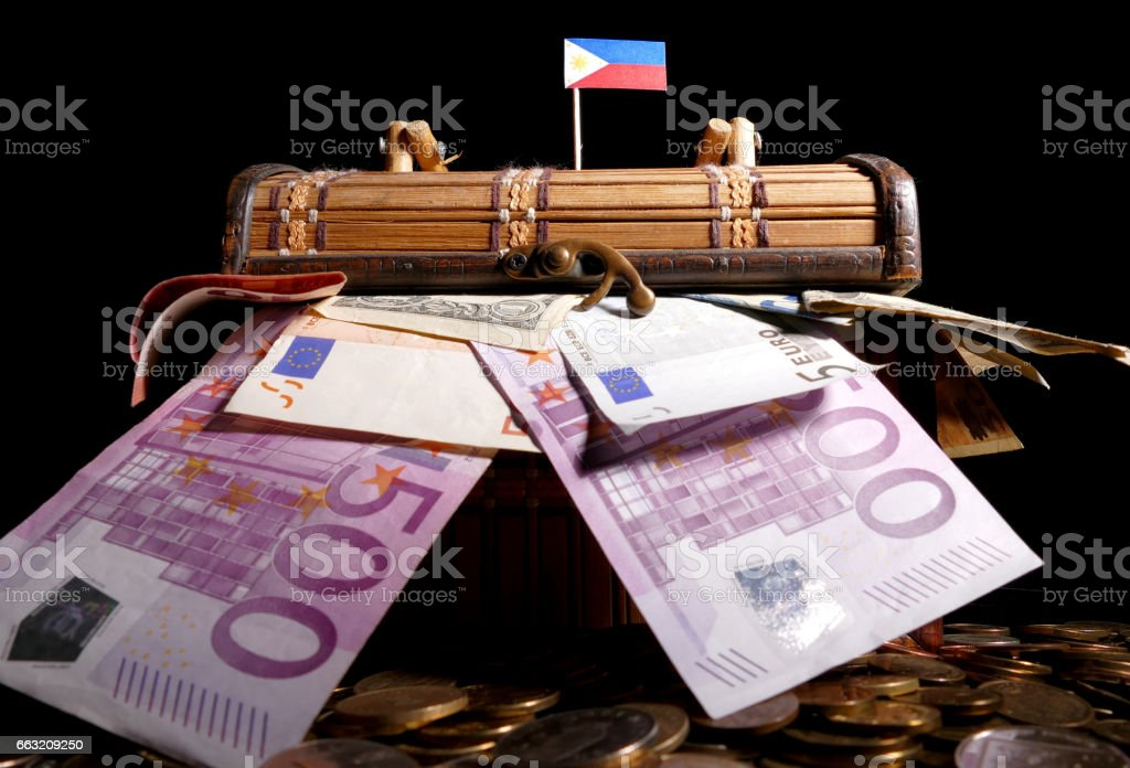 Philippine flag on top of crate full of money stock photo