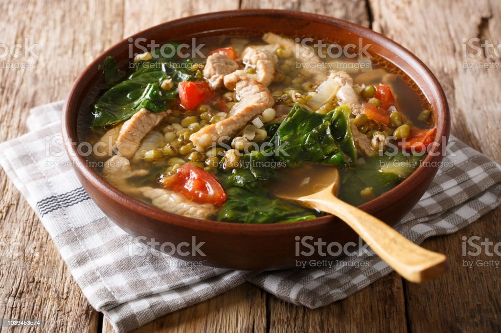 Philippine mung beans soup with pork closeup in a bowl. horizontal stock photo