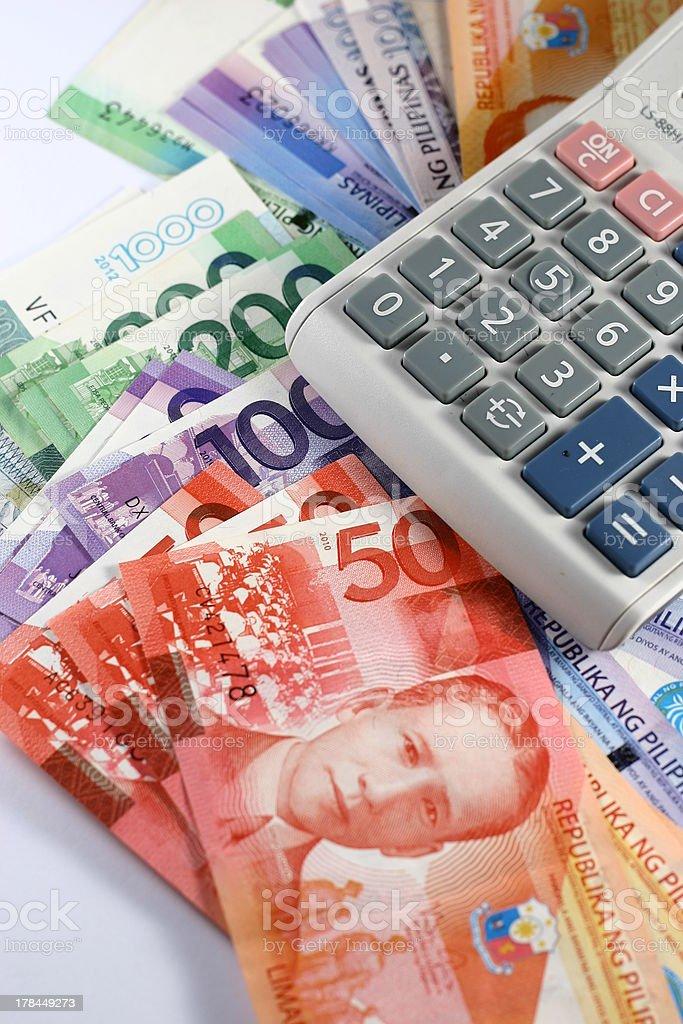 Philippine Peso Bills and Calculator stock photo