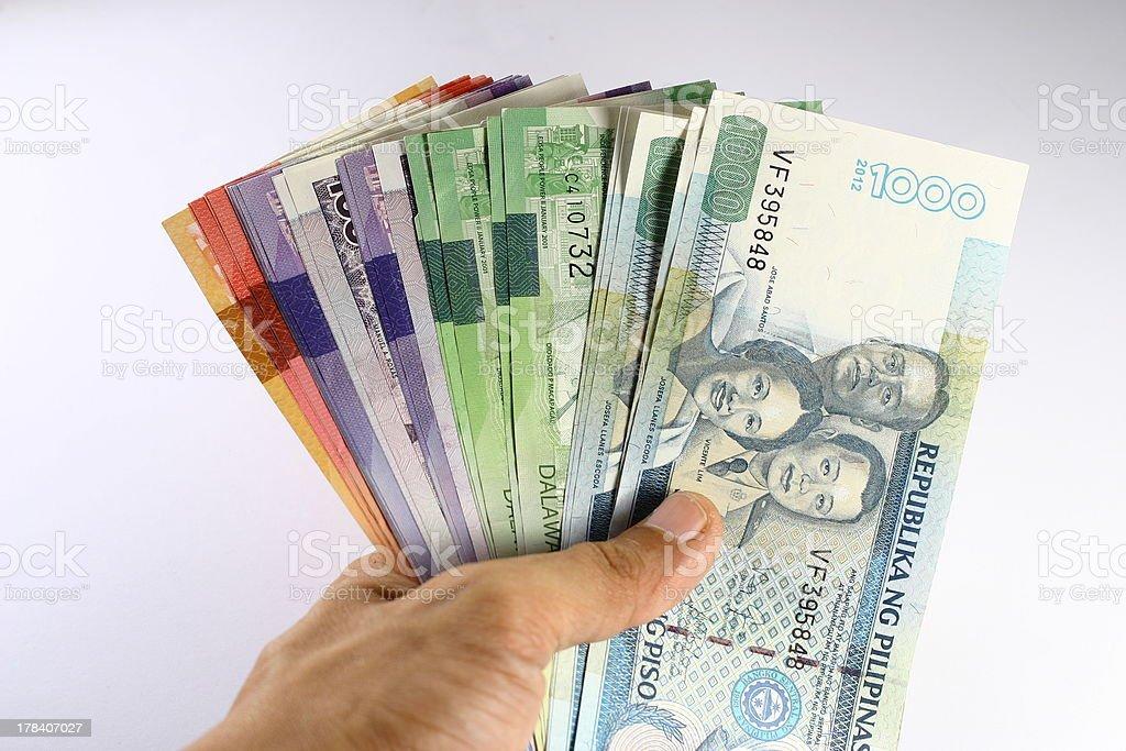 Philippine Peso Bills Held in Hand stock photo
