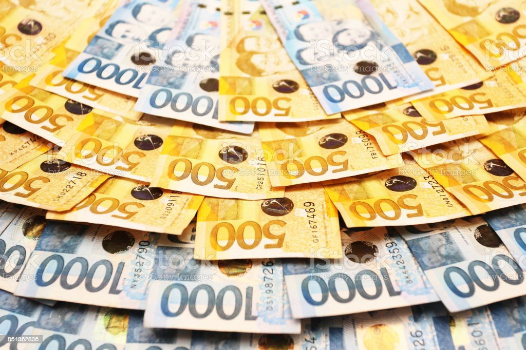 Philippine Peso (Php) bills (in 500 and 1000 denominations) stock photo