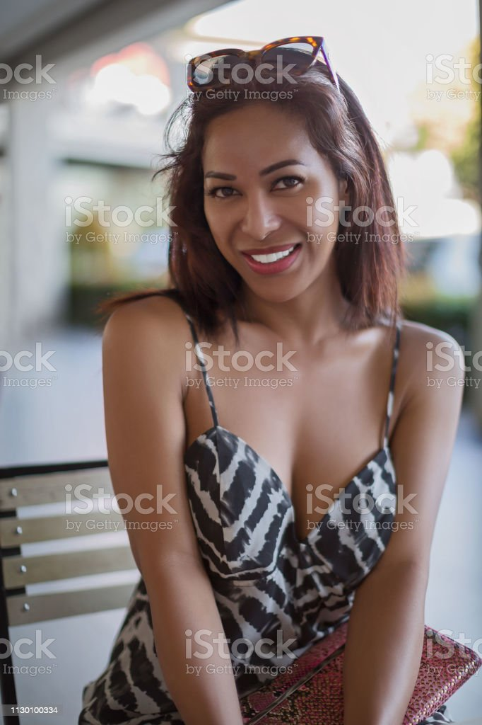 Philippines Ladyboy Transgender With Deep Decollete Cleavage Smiling And Look In The Camera Having Sunglasses