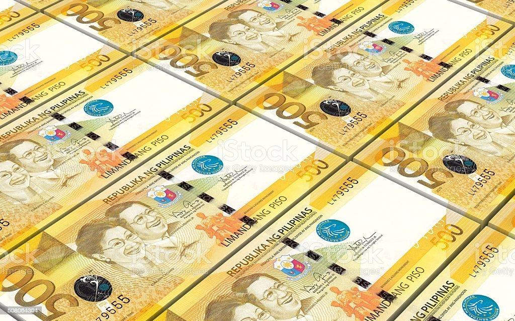 Philippines peso bills stacks background. stock photo