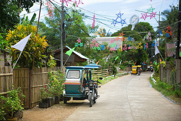 philippino village with christmas decorations - philippines stock photos and pictures