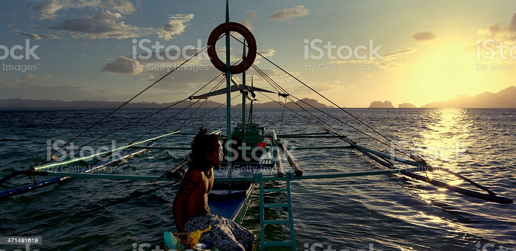 philippino with his traditional banca outrigger boats in the philippines stock photo