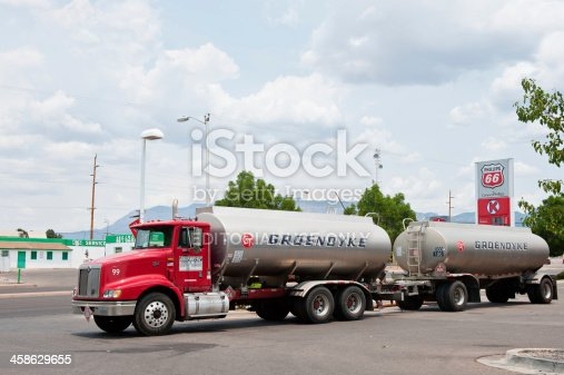 Albuquerque, New Mexico, USA - July 2, 2011: Phillips 66 gasoline and service station with Groendyke semi tanker truck and trailor in North East Albuquerque. Picture taken on partially cloudy day. Groendyke operates a large fleet of tank truck carriers that transport chemical, petroleum, and grain products from coast to coast, and to Mexico and Canada.