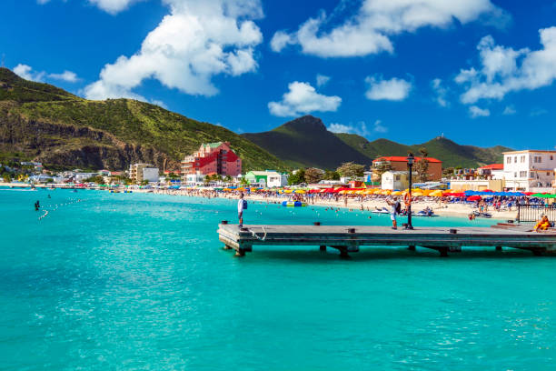 Phillipsburg beach in Dutch St Martin where there's resort hotels, beaches, boats and mountain scenery ready to enjoy