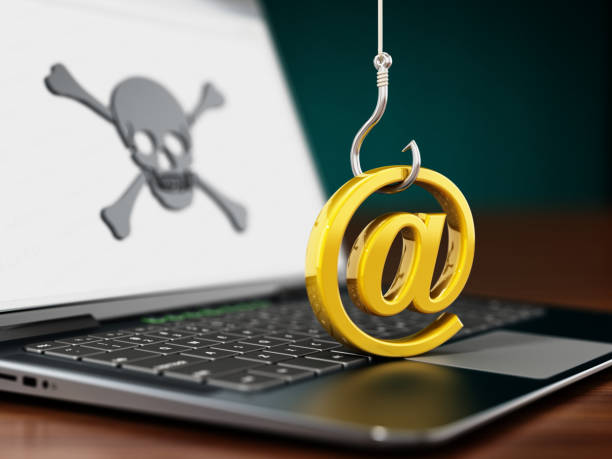 """Phishing attempt on laptop computer. Fish hook trying to steal """"at"""" sign Phishing attempt on laptop computer. Fish hook trying to steal """"at"""" sign. phishing stock pictures, royalty-free photos & images"""