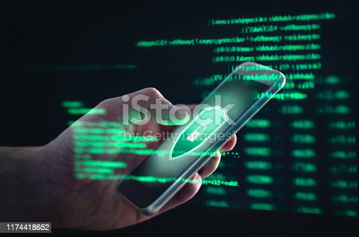 istock Phishing, cyber security, online information breach or identity theft crime concept. Hacked phone. Hacker and cellphone with hologram data. Mobile scam, fraud or crime. 1174418652