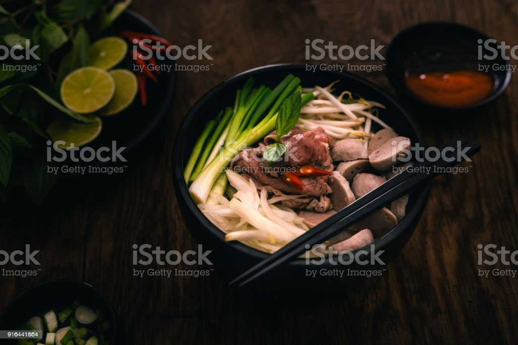 Pho bo, Vietnamese food, rice noodle soup with sliced beef stock photo
