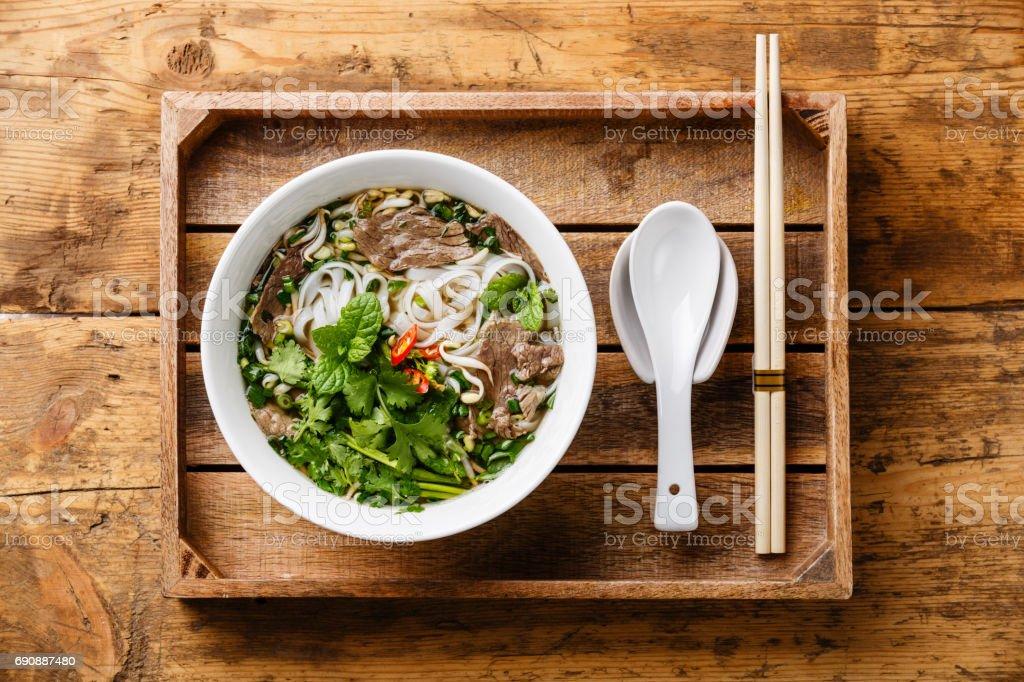 Pho Bo vietnamese Soup in wooden tray stock photo