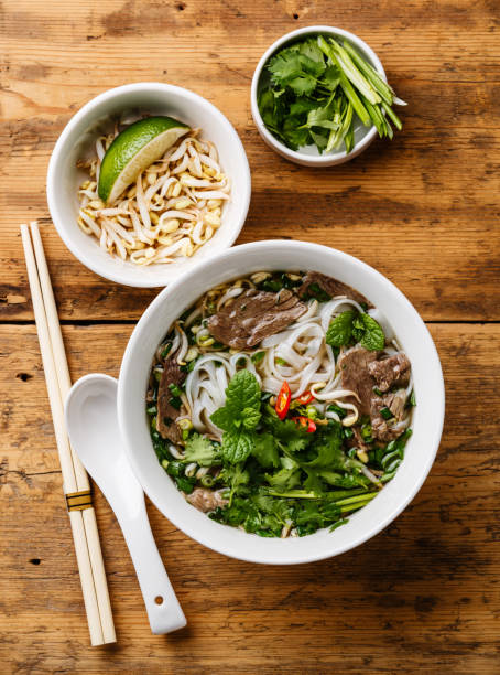 pho bo vietnamese soup - pho soup stock photos and pictures