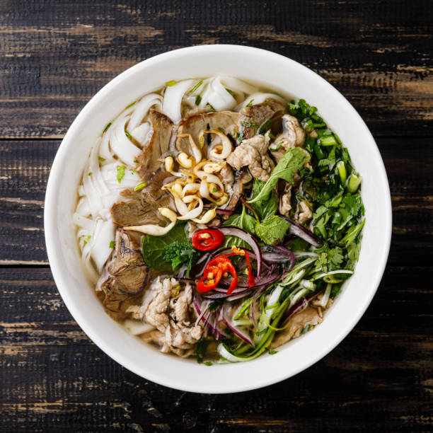 pho bo vietnamese soup with beef - pho soup stock photos and pictures