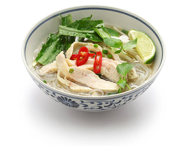 pho ga, vietnamese chicken rice noodle soup - pho soup stock photos and pictures